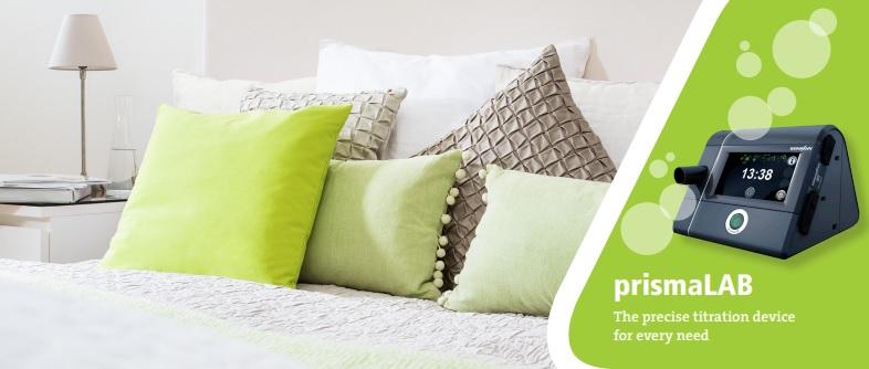 Zdjęcie PrismaLab - prezycyjnego urządzenia domiareczkowania natle domowego łóżka